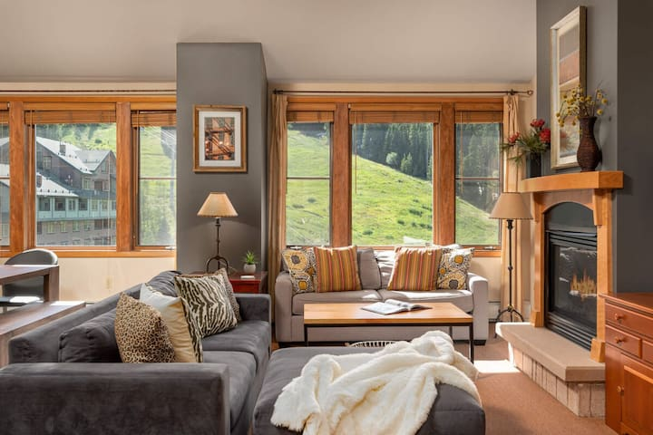 Mountain views surround you in the plush living room