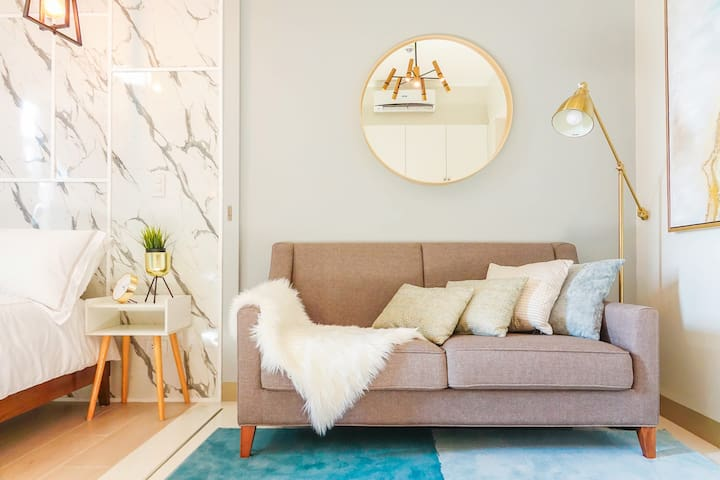 Situated in BGC's Uptown Community, this 36 sqm Luxury Scandinavian Minimalist inspired 1 bedroom  fully furnished decorated unit is a Piece of Modern Living.