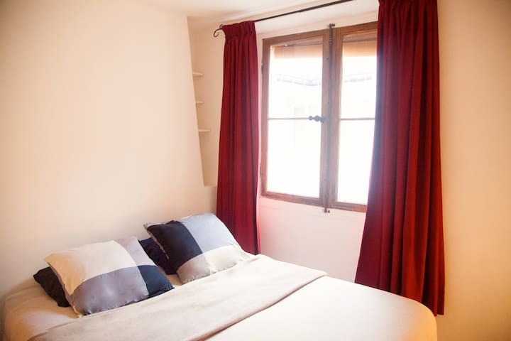 The first bedroom with a king size bed and a large window. You will enjoy its quietness