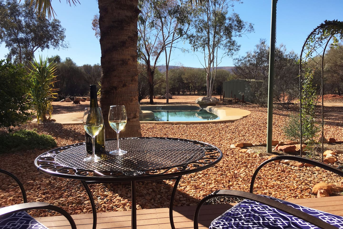 Guest deck looking out over the saltwater pool to the Macdonnell Ranges