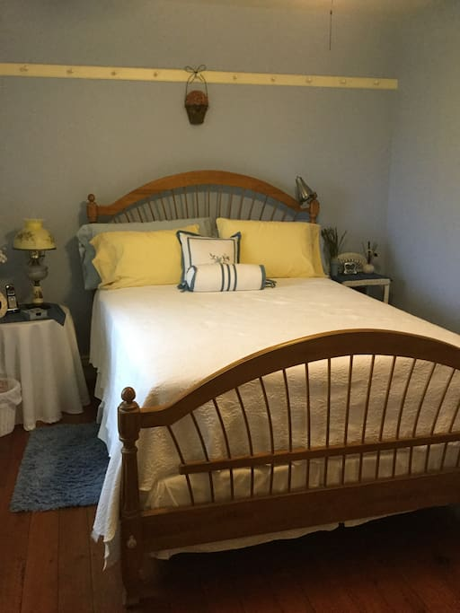 Queen bed, TV.  Shares hall bathroom with Plate room.