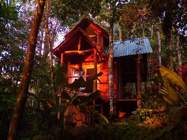 The tree house is tucked away in the jungle and is a convenient one minute walk from the main villa.