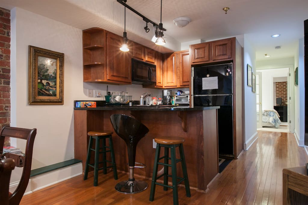 Great kitchen area with electric stoves