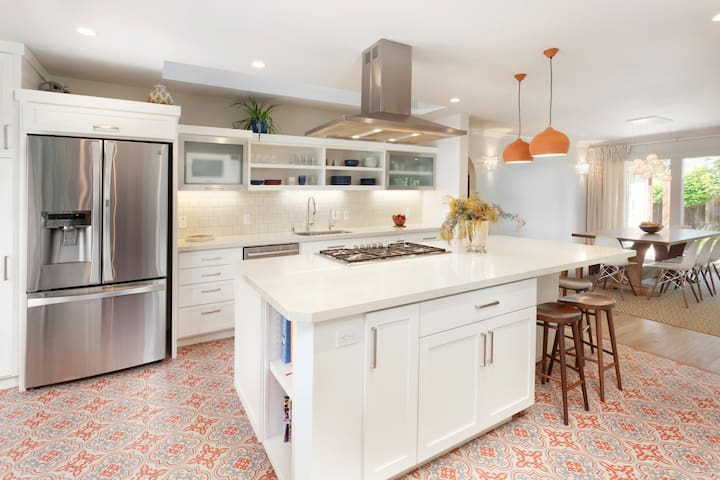 Amazing kitchen with modern appliances & large center island; opens to dining area and living area