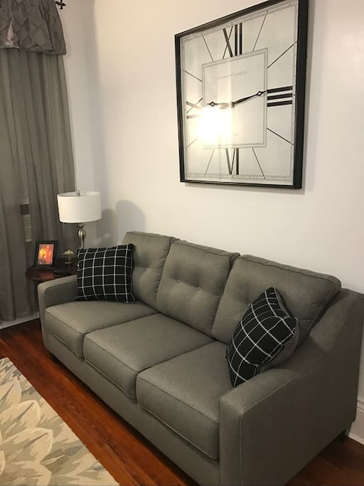 Living room with queen size sofa sleeper. flat screen tv, easy access to kitchen, dining area