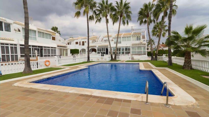 Palm lined pool apartment with solarium near beach