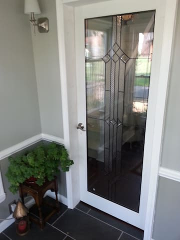 The Entrace from the enclosed front porch to the front hallway