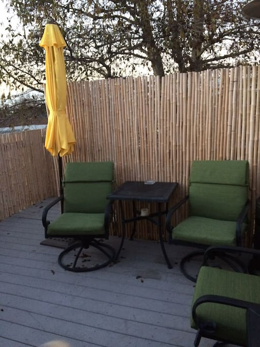 2017 new deck cushions, umbrella and wrap around privacy bamboo.