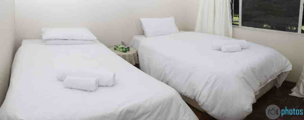 Bedroom A includes two twin beds and a mosquito nets to keep you comfortable!