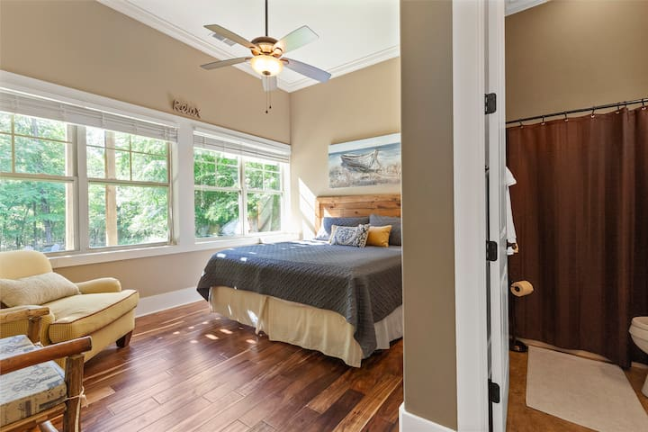 This downstairs king bedroom has an en suit full bath and a smart TV with cable and Netflix.