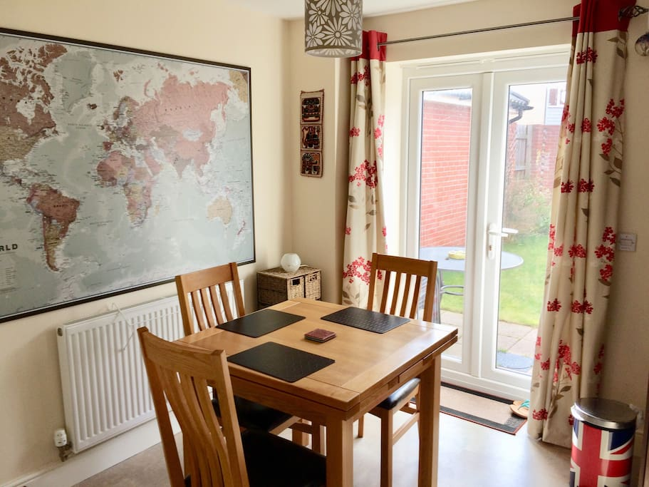 Dining area within the kitchen. Feel free to sit here to eat if you wish (and you can plan your next holiday by gazing at my lovely world map!)