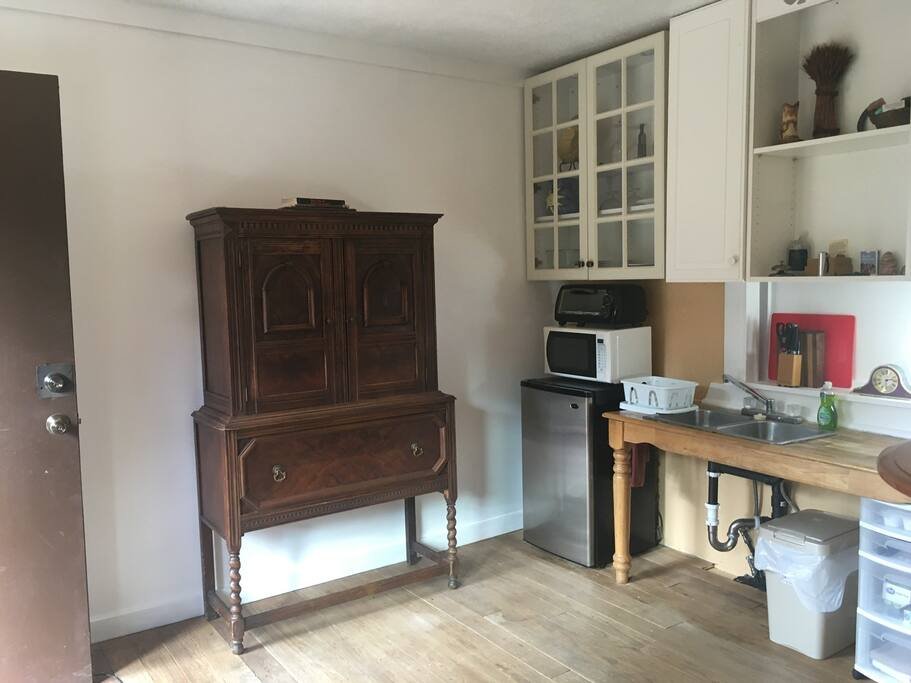 Antique hutch for storage and kitchenette area.