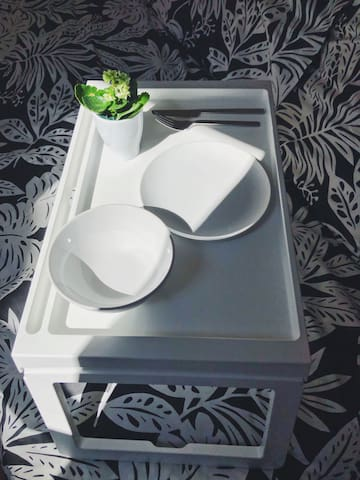 Tray is provided for a meal in bed.