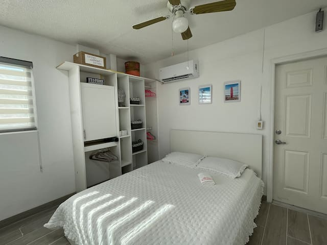 Like a hotel room, bedroom, shelves, kitchen and bathroom, own entrance.