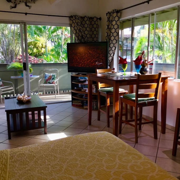 A large pup height table for enjoying inside dining while overlooking the tropical garden. Or on the outside lanai in 2 areas!