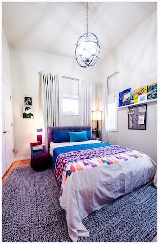 The guest bedroom features a queen sized bed and lots of light! The full size bathroom is just outside the door.