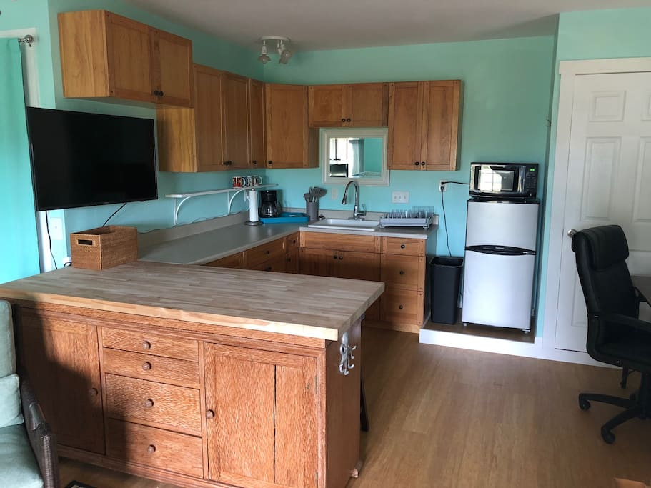 Kitchen has everything you need except a stove.  Gas grill located outside.