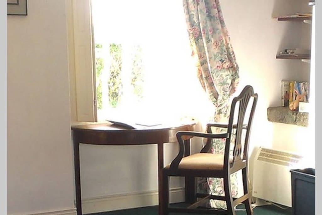 Little writing table in the sitting room looks out to the front of the cottage.