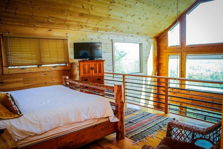 Master loft bedroom with TV