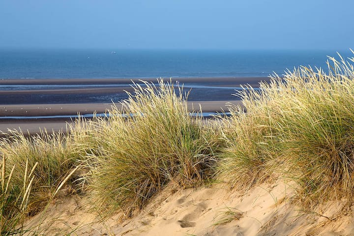 Over the sand dunes to the beach
