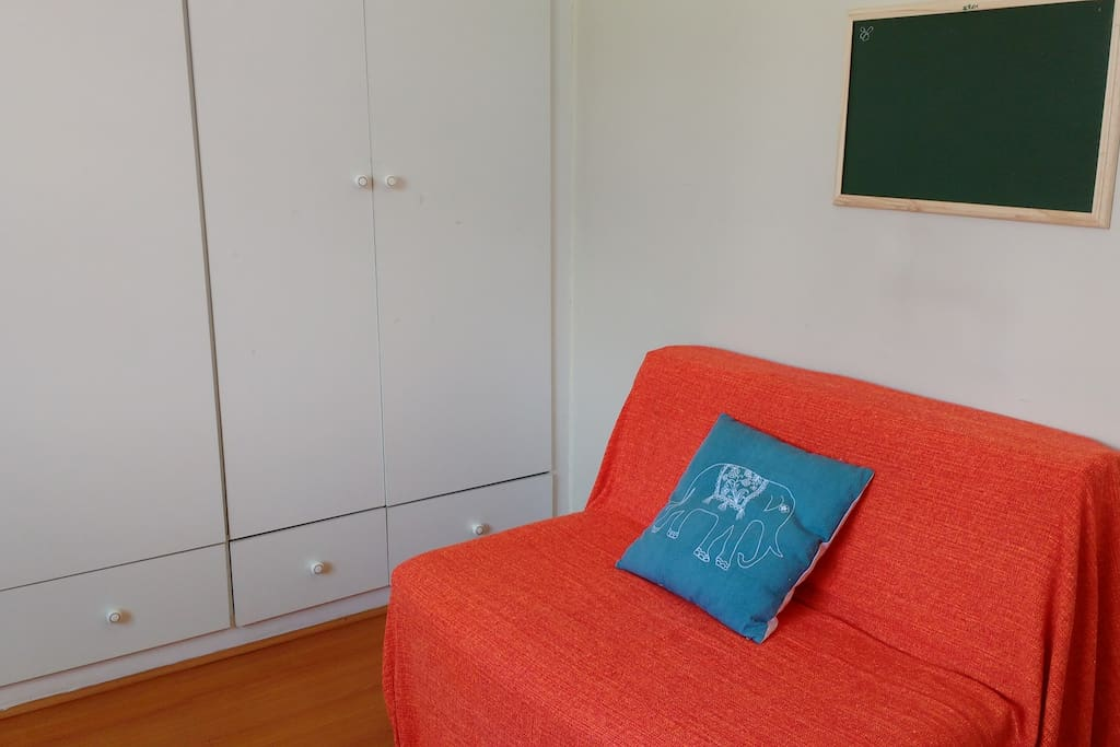 Private room with roomy wardrobe and sofa.