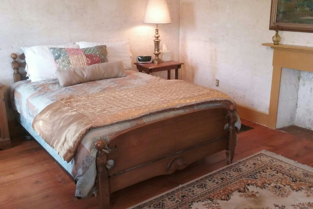 This sunny East bedroom has two windows, is spacious, filled with Antiques, and the colors here are gold and blue. There is a queen size bed and someday this room will have it's own private bathroom. It is our Best bedroom.