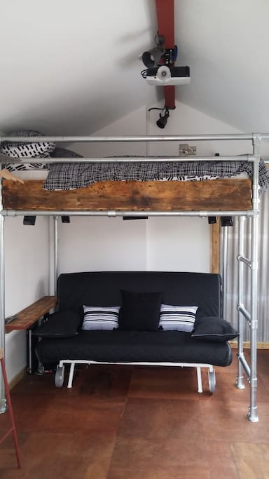 Mezzanine bed and sofa underneath