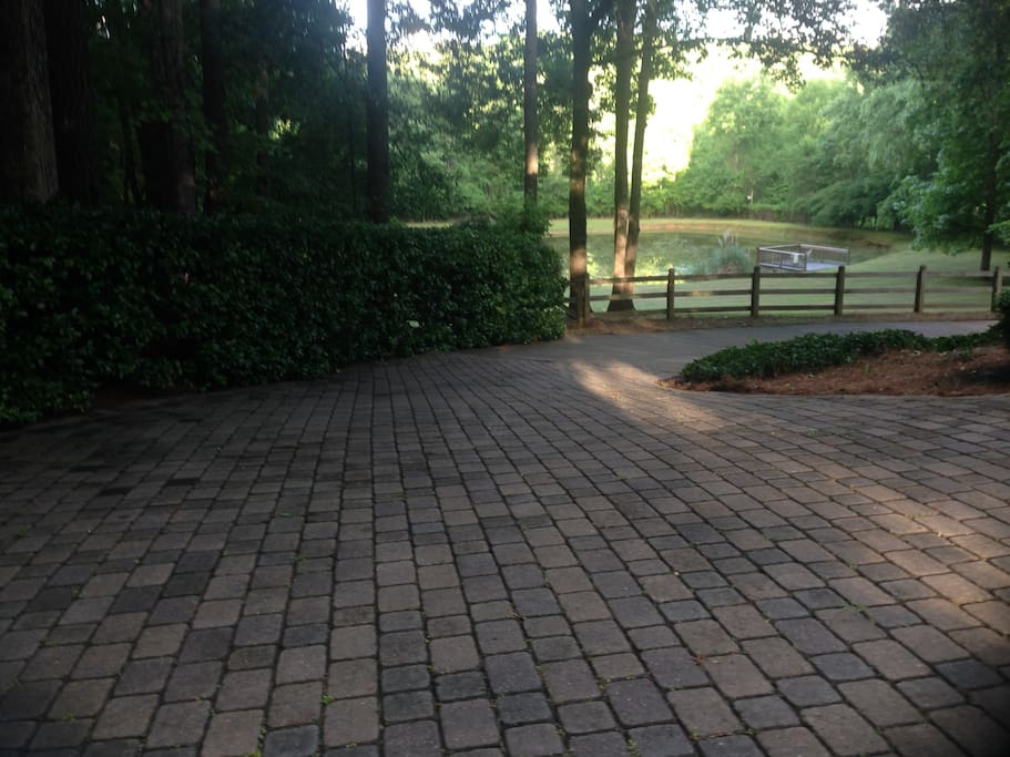 Ample parking and large yard with gated pond