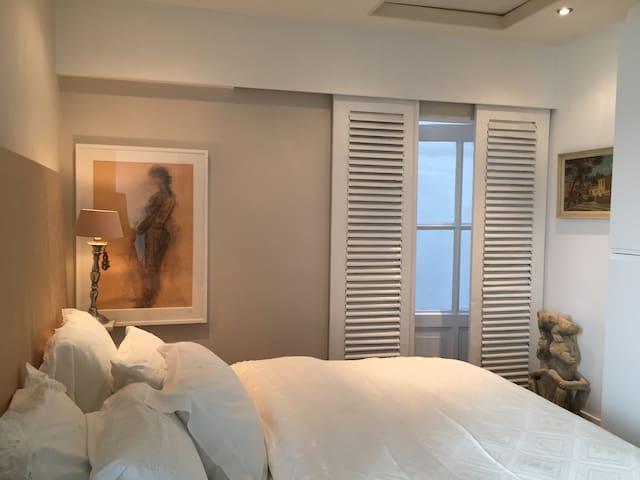 Quiet bedroom with door to private alley.