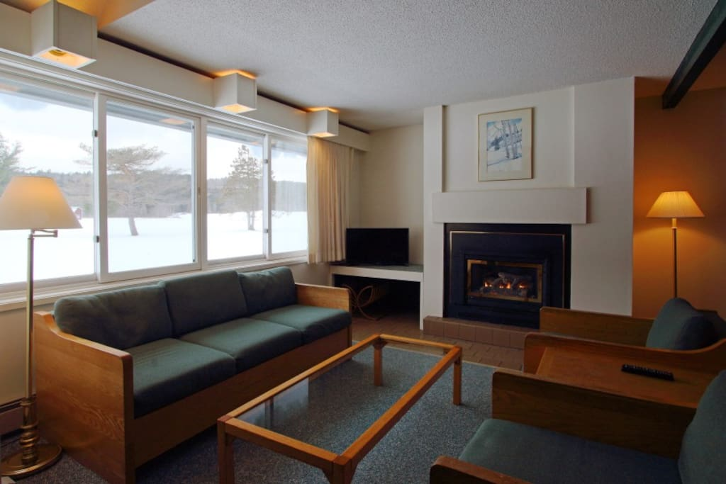 Living room with propane fireplace and views of Stowe Country Club greens.