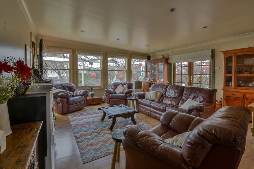 Large family room with plenty of seating and natural light
