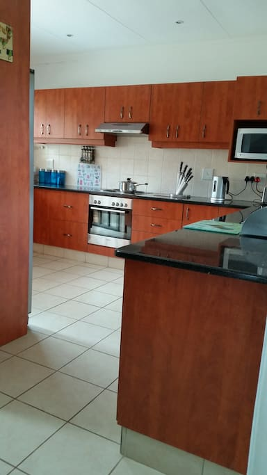 This is the kitchen  area, which has a back door which leads to a space for making braai/barbecue.