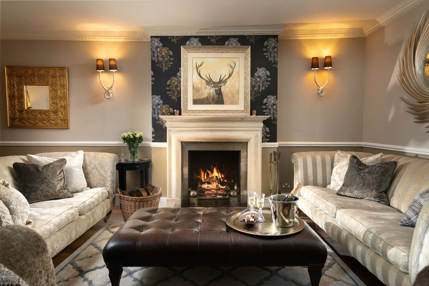 A very spacious sitting room comes with a seating area for 10 (3 sofas) around the fire which makes it perfect for winter days and nights. This stunning fireplace feature is made out of original Bath stone. There is a separate dining room and snug.