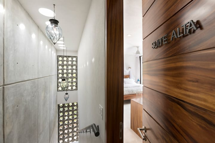 Going to second floor for top suite with private patio, en suite mini fridge and freezer, aircondicion, luxury bathroom, king size memory foam bed, fan above bed and on bathroom, mosquito net for your comfort