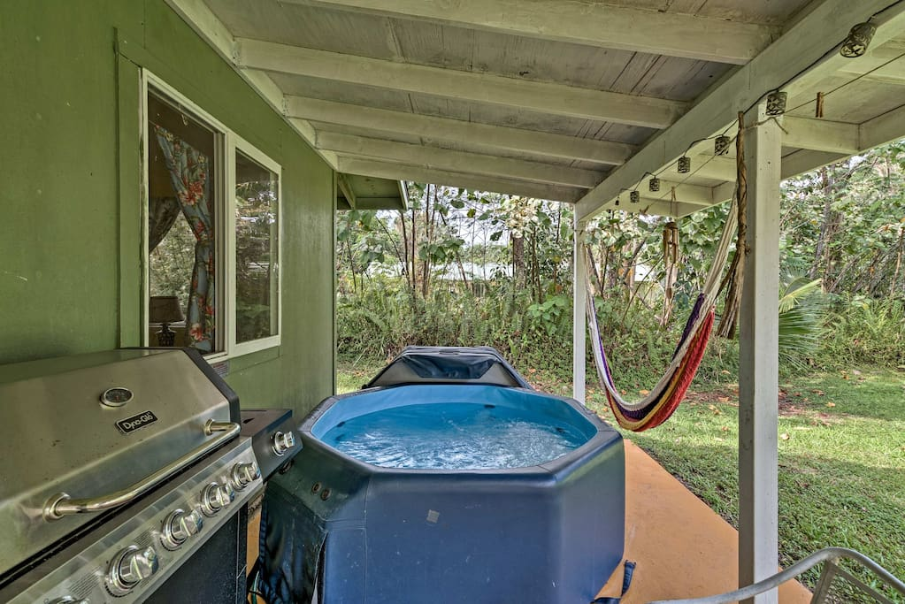The backyard features a hot tub, gas grill and hammock.
