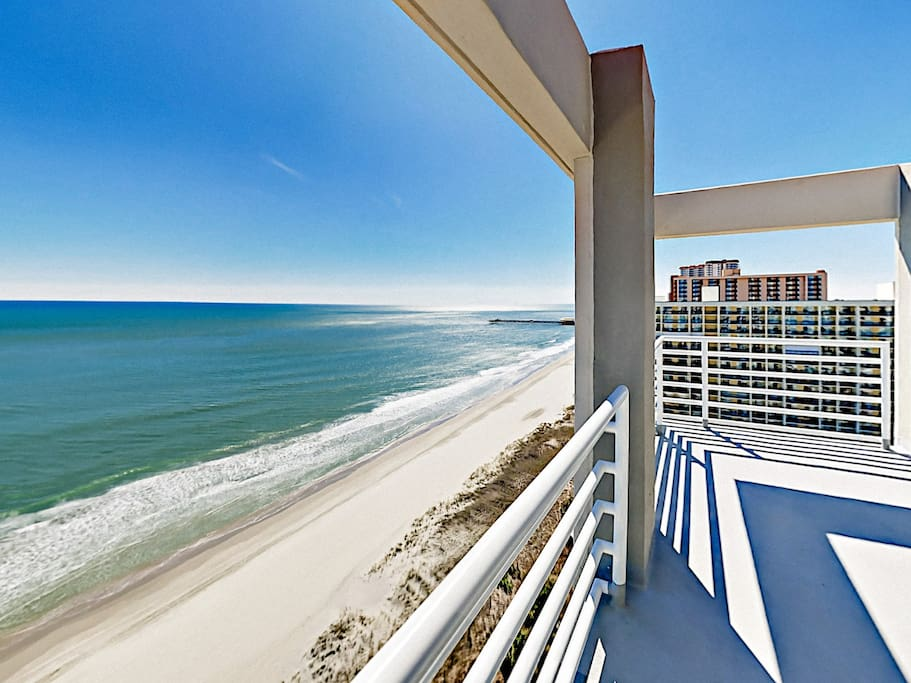 Wrap-around balcony with unobstructed ocean views, perfect for sun-soaked afternoons.