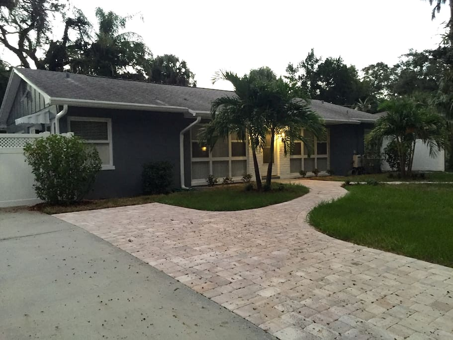 """Welcome to Bay Crest Villa  - The """"Montye""""-  Located in the Art District of Gulfport. Only 4 blocks to the village.  Villa has its own gated secure side entrance.   New soundproof interior walls, floors, kitchens,  laundry, and screened porch.  There is also an outside patio area.  Quality throughout."""