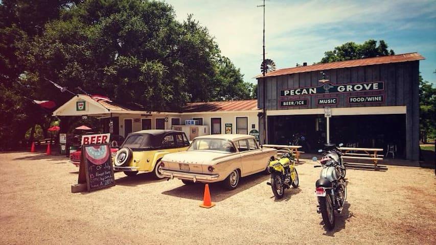 Pecan Grove Store next door. They have burgers/live music/beer/etc