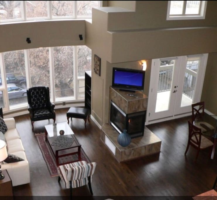 Bright living space and dining area, with super high ceilings and access to balcony.