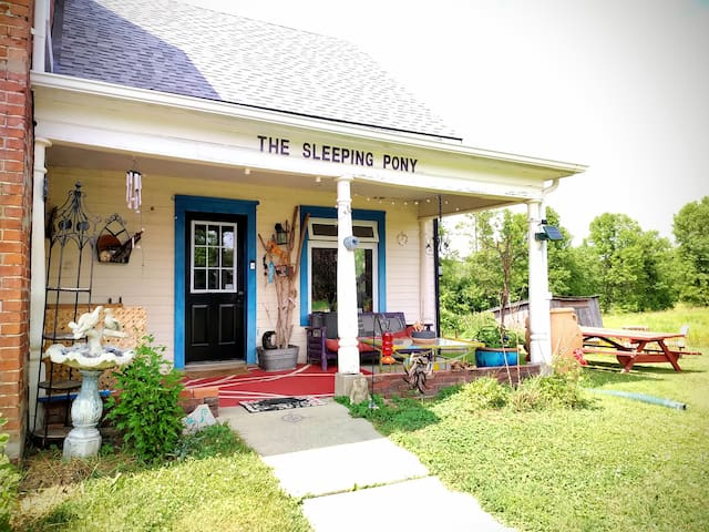 The entrance to The Sleeping Pony. It is a 1930s addition to the original 1850s farm house.  It is infused with the feel of a turn of the century cottage with modern amenities.