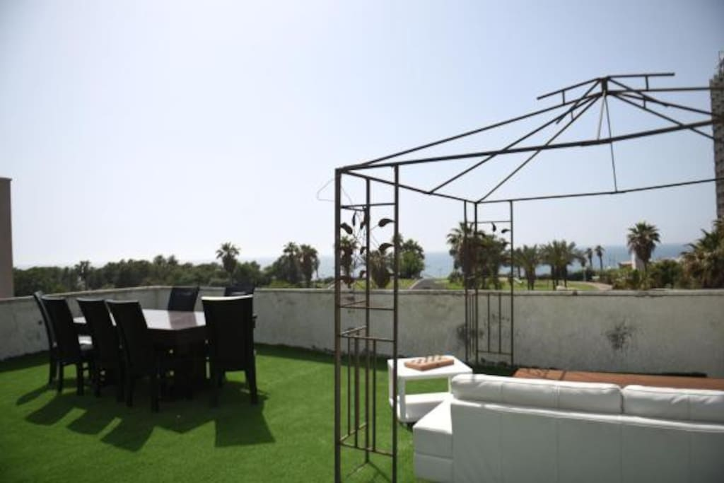 HUGE Rooftop with seating and SEA VIEWS!