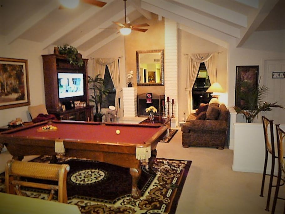 Game and Sports room with bar