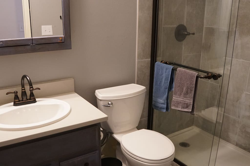 The bathroom is clean and recently remodeled and includes a spacious shower.