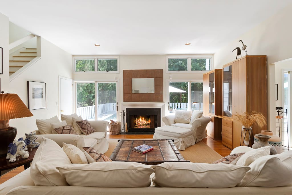 Easy living in the Hamptons. Double height living room opens onto spacious deck and pool