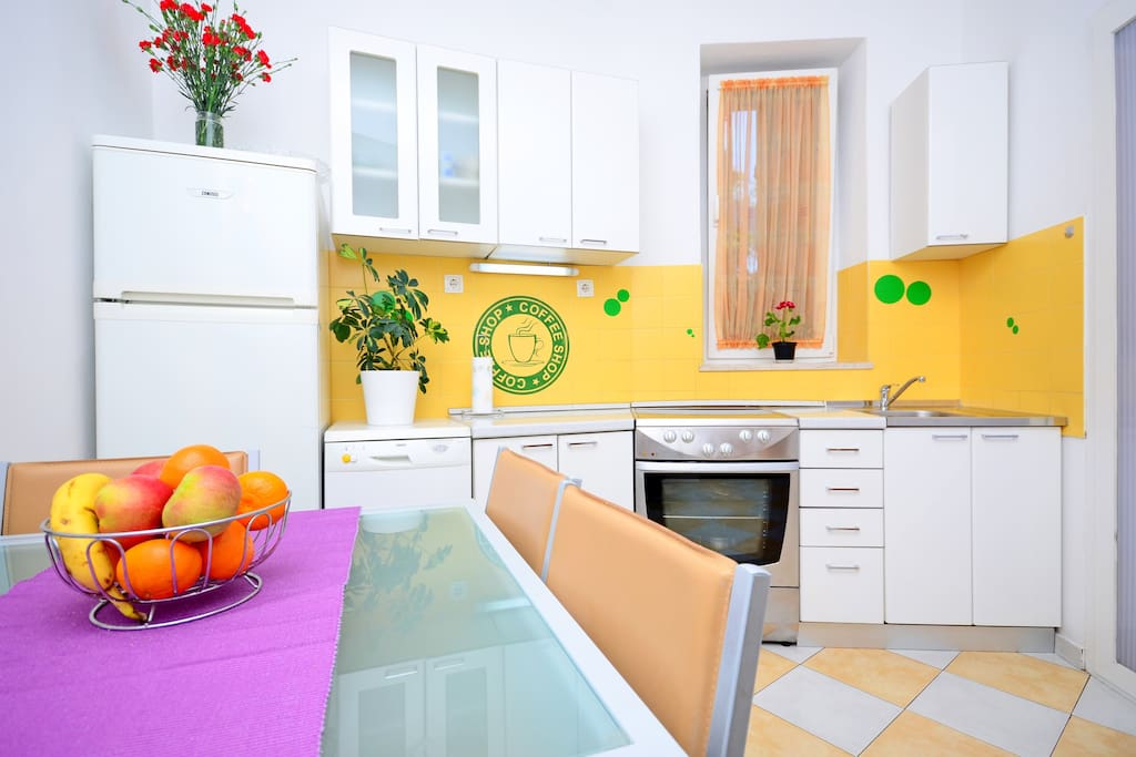 Kitchen with all supplies: refrigerator, dishwasher, kitchen stove and oven..