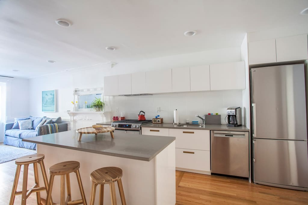 Gourmet kitchen with island, dishwasher and  all new appliances.