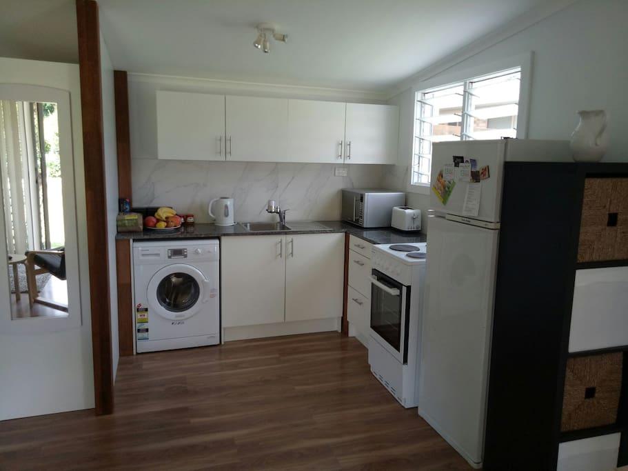 Full Kitchen & washing machine.