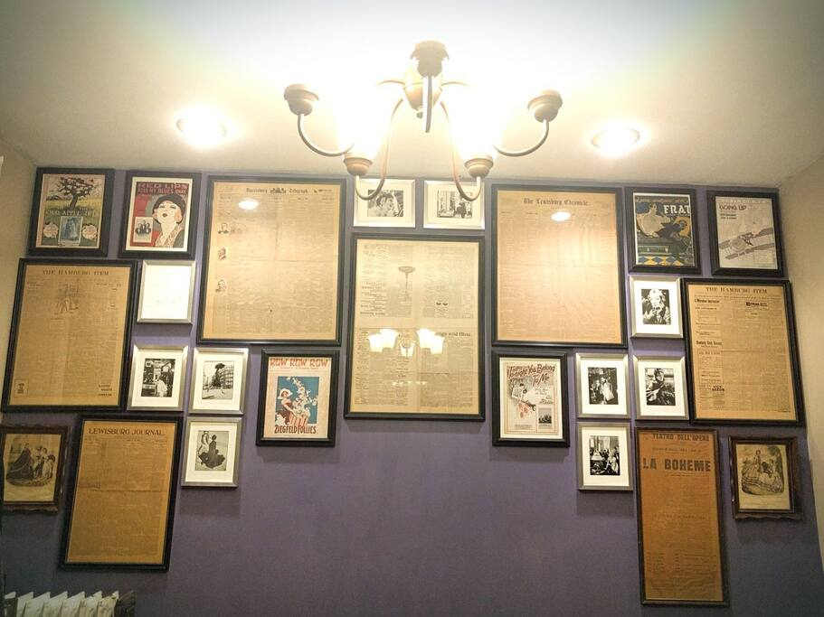 The Dining Room's feature wall of antique newspapers, Richard Avedon fashion plates and 1910-20s sheet music.