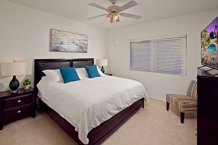 Bedroom 3: Comfy king bed, private TV. Located Upstairs.