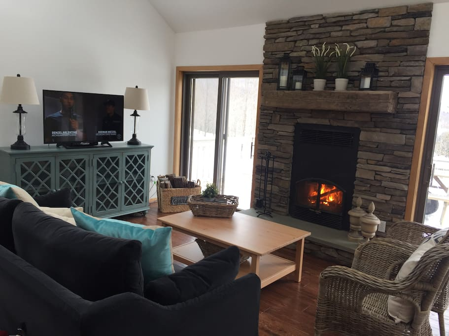 Five Star Cottage - Beautifully decorated living room with wood burning fireplace and Smart TV with WiFi